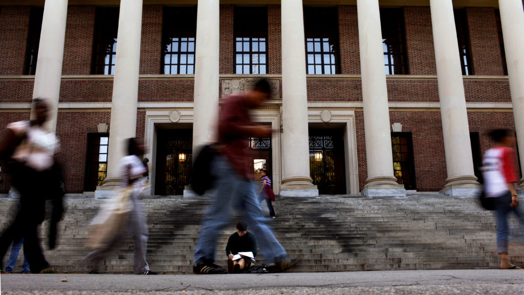 A students sits on the steps of Widener Library at Harvard University in Cambridge, Massachusetts. Photo by Brian Snyder/Reuters