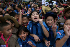 Students celebrate in front of the hospital in northern Thailand where the 12 soccer players and their coach rescued from the cave complex are being treated on July 11. Photo by Athit Perawongmetha/Reuters