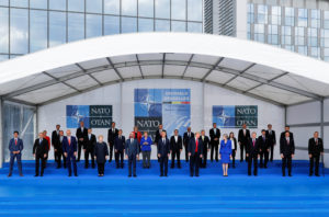 NATO leaders pose for a photo at the start of the NATO summit in Brussels, Belgium on July 11. Photo by Yves Herman/Reuters