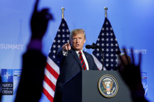 President Donald Trump takes questions from the media during a news conference after participating in the NATO Summit in Brussels, Belgium. Photo by Kevin Lamarque/Reuters