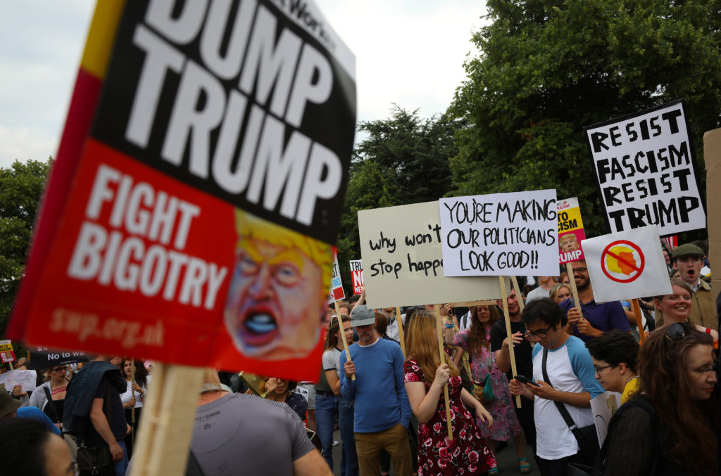 Demonstrators protest next to the specially erected fence surrounding the U.S. ambassador's residence, Winfield House, where President Donald Trump and first lady Melania Trump are staying in London on July 12. Photo by Simon Dawson/Reuters