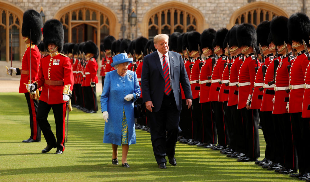 U.S. President Donald Trump and Britain's Queen Elizabeth inspect the Coldstream Guards during a July visit to Windsor Castle in Windsor, Britain. Photo by Kevin Lamarque/Reuters