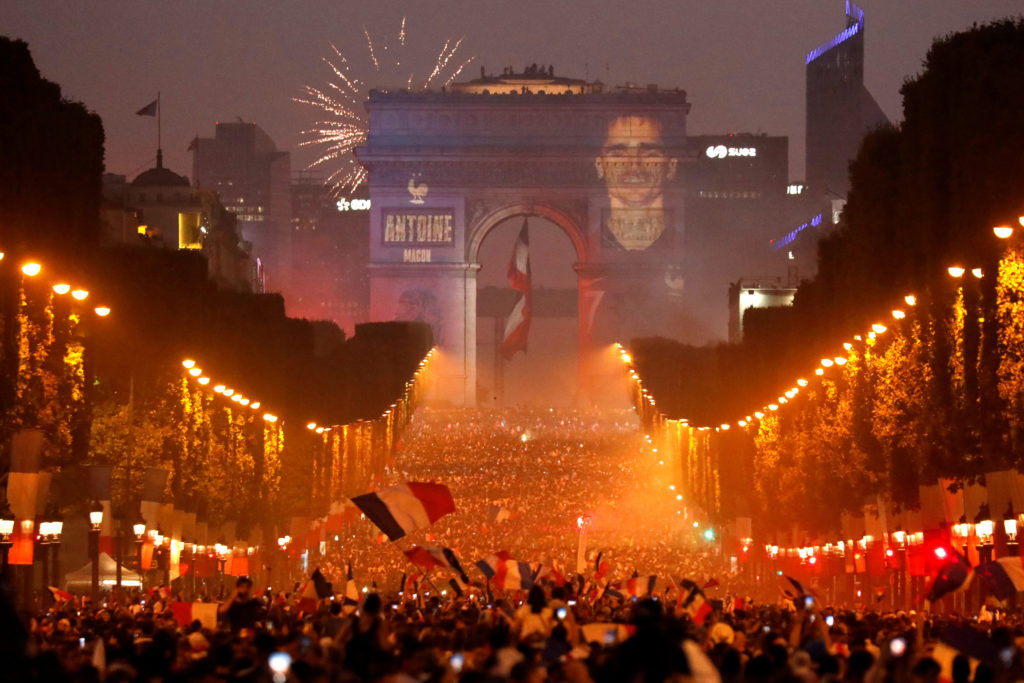 A giant picture of France's Antoine Griezmann is seen on the Arc de Triomphe as France fans celebrate on the Champs-Elysees Avenue after France won the Soccer World Cup final. Photo by Charles Platiau/Reuters