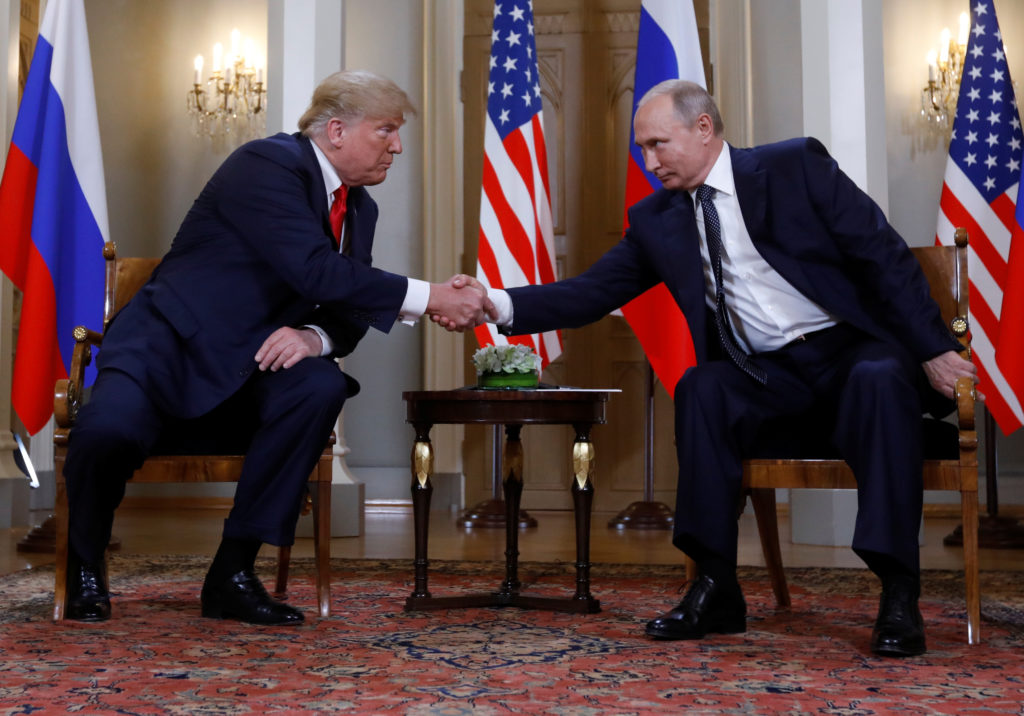President Donald Trump and Russia's President Vladimir Putin shake hands as they meet in Helsinki, Finland, on July 16, 2018. Photo by Kevin Lamarque/Reuters