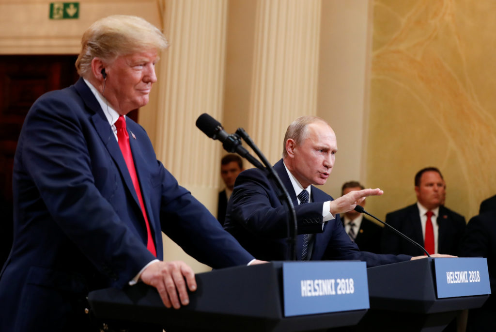 Russia's President Vladimir Putin gestures during a joint news conference with U.S. President Donald Trump after their meeting in Helsinki, Finland, on July 16, 2018. Photo by Kevin Lamarque/Reuters
