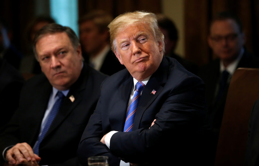 Secretary of State Mike Pompeo and President Donald Trump listen during a cabinet meeting at the White House in Washington, D.C. Photo by Leah Millis/Reuters