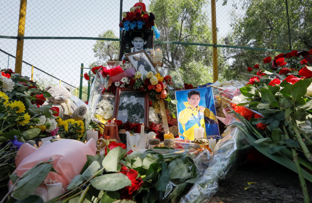 Candles, flowers, and photos of the assassinated Kazakhstan's Olympic figure skater Denis Ten are seen at the makeshift memorial in Almaty, Kazakhstan. Photo by Shamil Zhumatov/Reuters