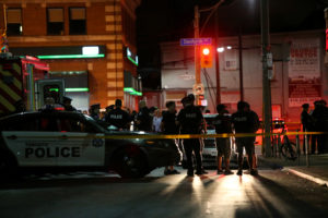 Police are seen near the scene of a mass shooting in Toronto, Canada. Photo by Chris Helgren/Reuters