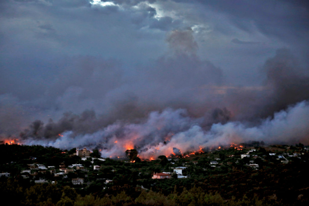 A wildfire rages in the town of Rafina, near Athens, Greece. Photo by Alkis Konstantinidis/Reuters