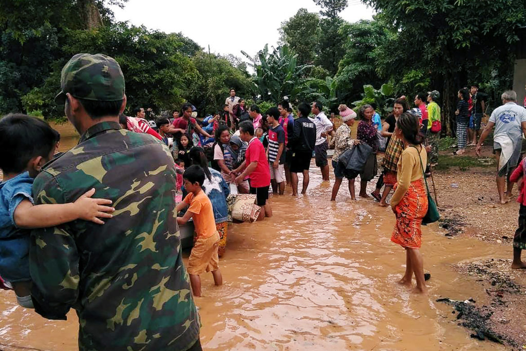 Villagers carry their belonging as they evacuate after the Xepian-Xe Nam Noy hydropower dam collapsed in Attapeu province, Laos. Photo by Reuters