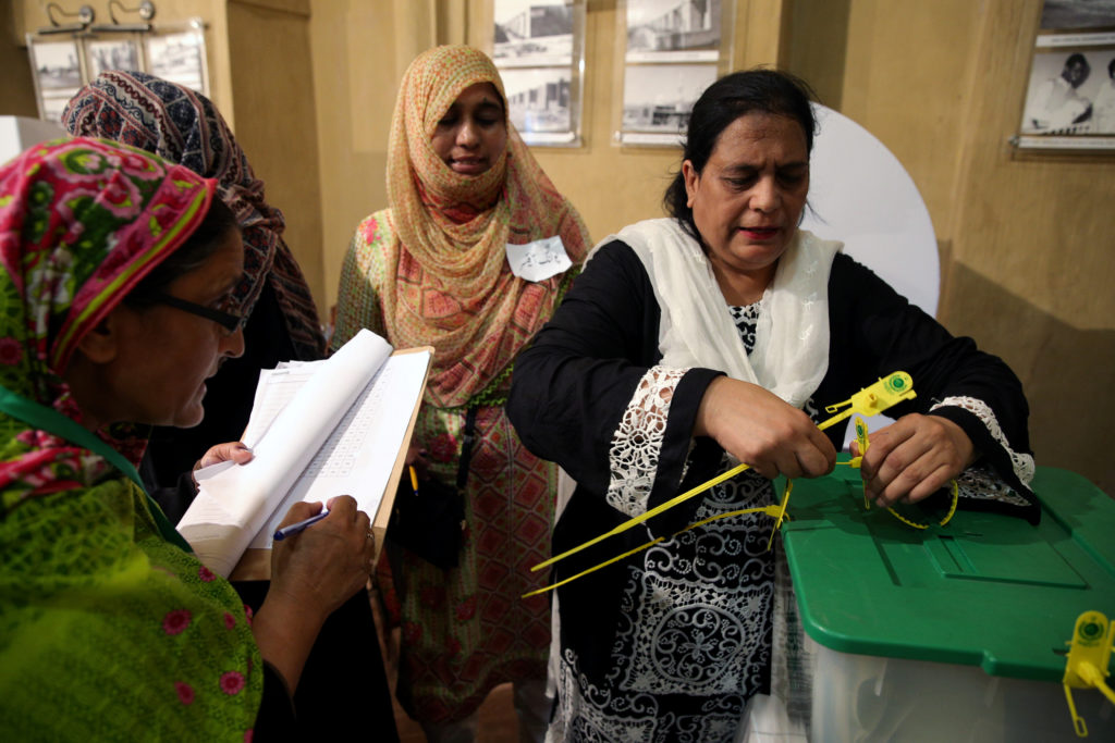 An election official seals a ballot box after polls closed in Islamabad, Pakistan on July 25. Photo by Athit Perawongmetha/Reuters