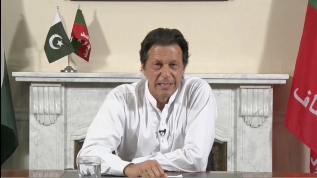 Imran Khan, chairman of Pakistan Tehreek-e-Insaf (PTI), gives a televised victory speech in Islamabad following Wednesday's general election in Pakistan. PTI handout/via Reuters