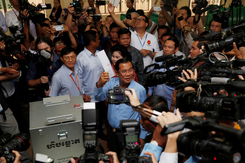 Cambodia's Prime Minister and President of the Cambodian People's Party (CPP) Hun Sen prepares to cast his vote at a polling station during a general election in Takhmao, Kandal province, Cambodia. Photo by Darren Whiteside/Reuters