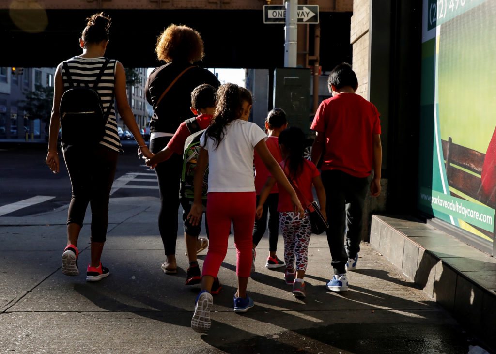 Children are escorted to the Cayuga Center, which provides foster care and other services to immigrant children separated from their families, in New York City, U.S., July 10, 2018. Photo by Brendan McDermid/Reuters