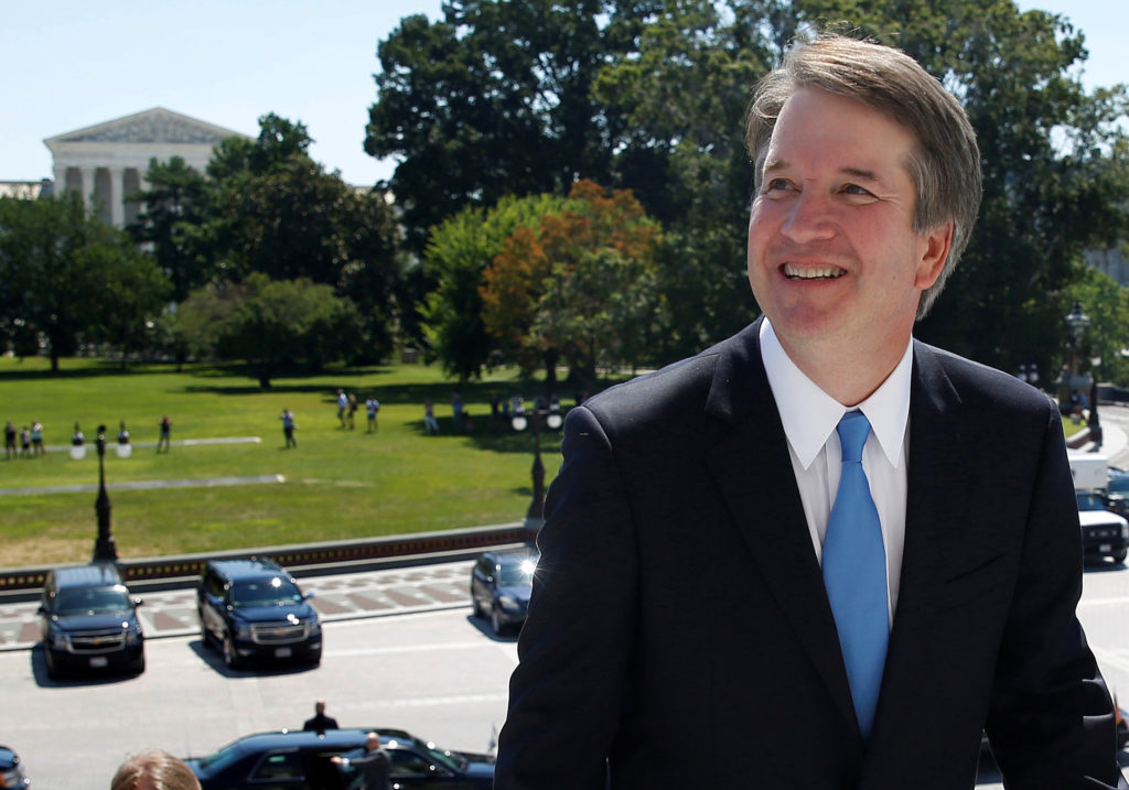 With the U.S. Supreme Court building in the background, Supreme Court nominee judge Brett Kavanaugh arrives prior to meeting with Senate Majority Leader Mitch McConnell on Capitol Hill in Washington, U.S., July 10, 2018. REUTERS/Joshua Roberts - RC1289DFD4F0