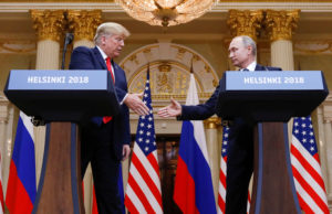 President Donald Trump and Russia's President Vladimir Putin shake hands during a joint news conference after their meeting in Helsinki, Finland. Photo by Kevin Lamarque/Reuters