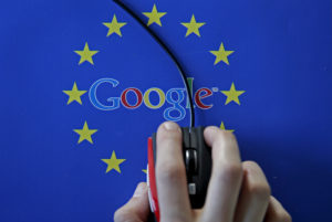 A woman hovers a mouse over the Google and European Union logos in this April 15, 2015 photo illustration. This logo has been updated and is no longer in use. Photo by Dado Ruvic/Illustration/File Photo via Reuters