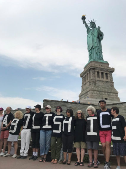 The group Rise and Resist stage a protest at the Statue of Liberty in New York, U.S. July 4, 2018 in this picture obtained from social media. Rise and Resist/via REUTERS