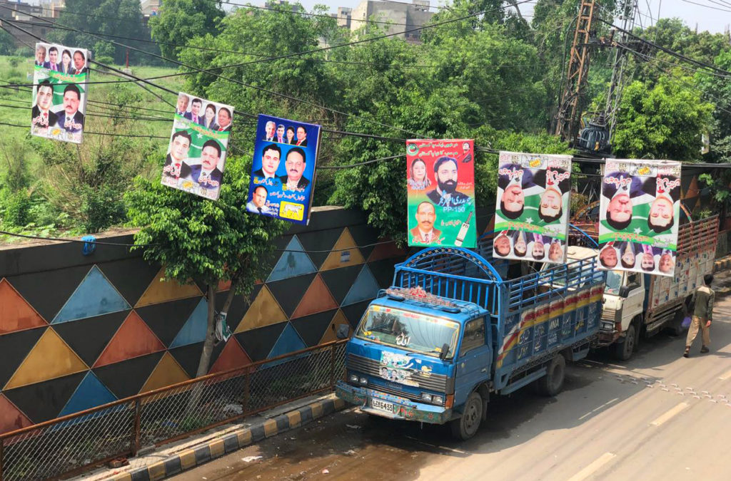 Election banners hang above a street in Lahore, Pakistan. Photo by Sumaira Latif