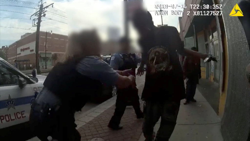 Chicago Police attemps to grab Harith Augustus, 37, who fatally shot by police moments later, in this still image from police body camera video footage taken in Chicago, Illinois, U.S. on July 14, 2018 and released on July 15, 2018. Chicago Police Department Courtesy Chicago Police Department/Handout via REUTERS ATTENTION EDITORS - THIS IMAGE HAS BEEN SUPPLIED BY A THIRD PARTY. - RC164E7B1B30