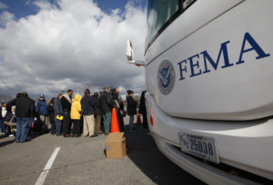 People wait in line to meet with FEMA officials in Coney Island, New York, November 2, 2012. Four days after Sandy smashed into the Northeast, rescuers were still discovering the extent of the death and devastation, and anger mounted over gasoline shortages, power outages and waits for relief supplies. REUTERS/Brendan McDermid