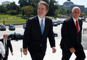 With the U.S. Supreme Court building in the background, Supreme Court nominee judge Brett Kavanaugh arrives with U.S. Vice President Mike Pence prior to meeting with Senate Majority Leader Mitch McConnell on Capitol Hill in Washington, U.S., July 10, 2018. REUTERS/Joshua Roberts