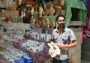 A man polishes his wares at a market in Karachi. Photo by Larisa Epatko/PBS NewsHour