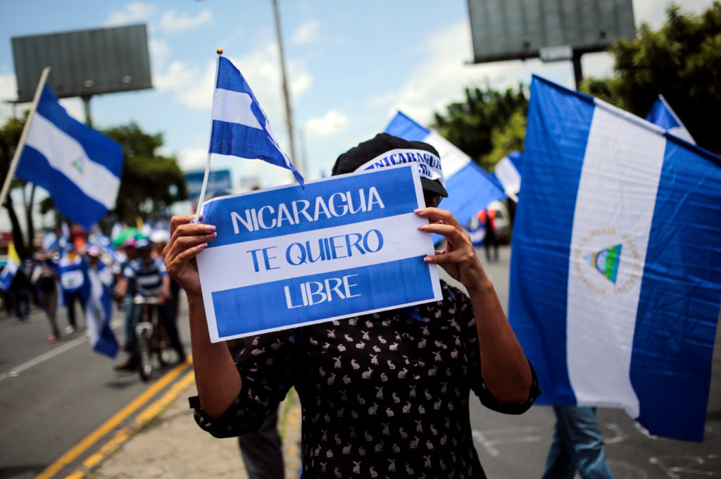 "A demonstrator holds a banner that reads"" ""Nicaragua I want free"" during a march in support of the Catholic Church in Managua, Nicaragua July 28, 2018.REUTERS/Oswaldo Rivas"