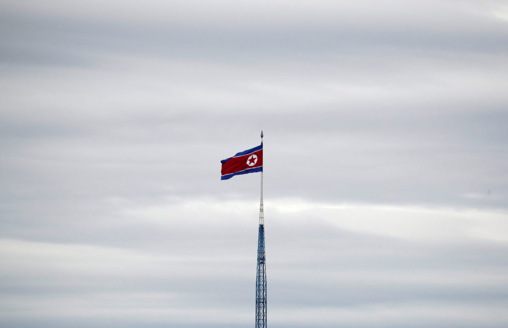 A North Korean flag flutters on top of a 160-metre tower in North Korea's propaganda village of Gijungdong, in this picture taken from the Tae Sung freedom village near the Military Demarcation Line (MDL), inside the demilitarised zone separating the two Koreas, in Paju, South Korea, April 24, 2018. REUTERS/Kim Hong-Ji