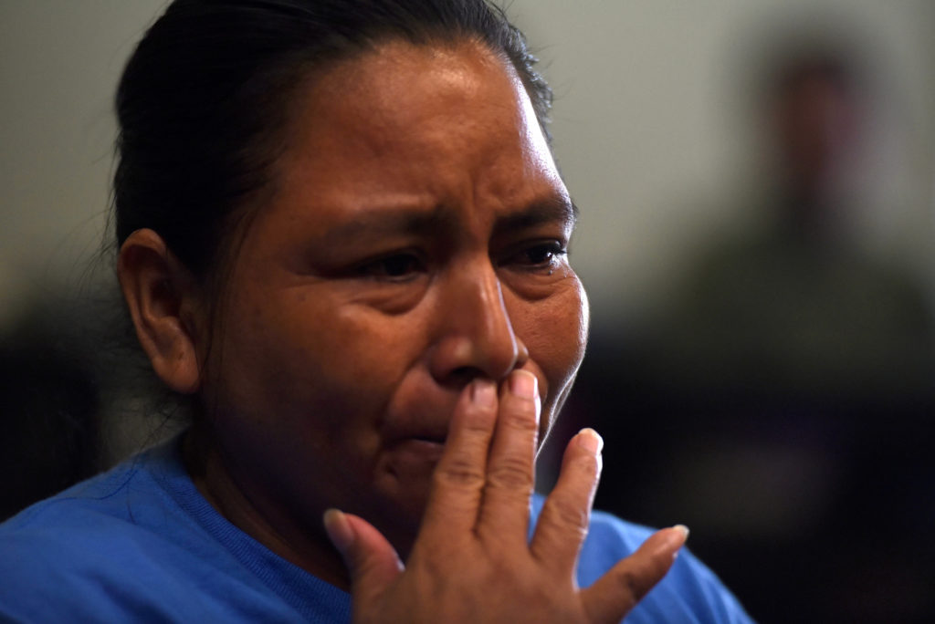 After being reunited with her daughter, Sandra Elizabeth Sanchez, of Honduras, speaks with media at Catholic Charities in ...