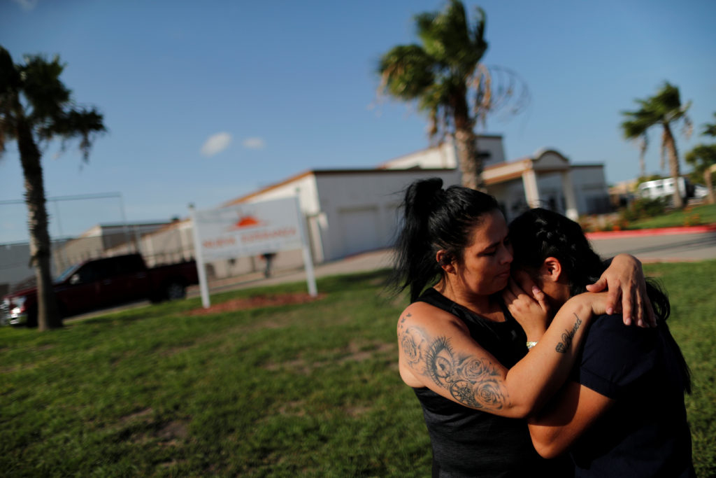 Isabela, an asylum seeker from El Salvador, hugs her 17-year-old daughter Dayana outside of Casa Esperanza, a federal contracted shelter, shortly after being reunited with her following their separation at the U.S.-Mexico border, in Brownsville, Texas, U.S., July 11, 2018. Picture taken July 11, 2018. REUTERS/Carlos Barria