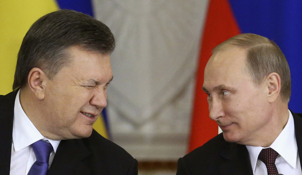Ukrainian President Viktor Yanukovich (L) gives a wink to his Russian counterpart Vladimir Putin during a signing ceremony after a meeting of the Russian-Ukrainian Interstate Commission at the Kremlin in Moscow, December 17, 2013. Russia is planning to buy $15 billion worth of Ukraine's upcoming eurobonds using money from a sovereign wealth fund this year and next, Russian Finance Minister Anton Siluanov said on Tuesday. REUTERS/Sergei Karpukhin