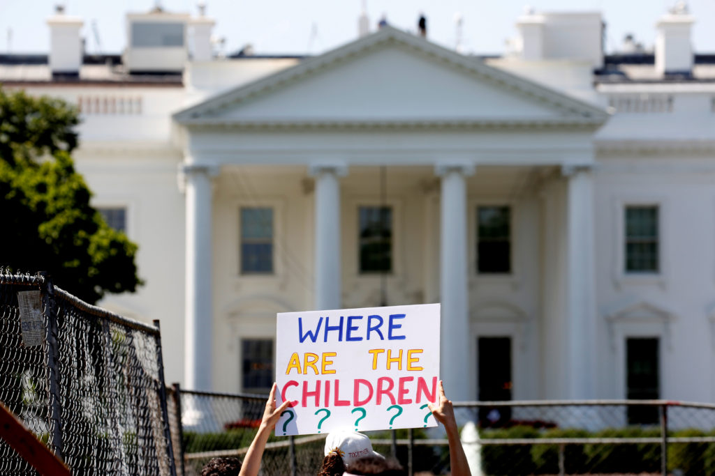 An immigration activists hold signs against family separation durin…