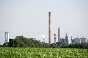 Smokestacks and cooling towers seen across a field of crops at the facility where a fire broke out at a key gasoline-making unit at a PBF Energy Inc refinery in Delaware City, Delaware August 21, 2015. PBF Energy Inc shut down the unit, and is running the rest of the plant at reduced rates, the company said. Photo by Charles Mostoller/Reuters.
