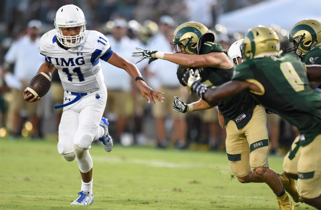 FIEL PHOTO: IMG Academy quarterback Kellen Mond (11) runs against the Grayson Rams during the second half in a high school football duel of top ranked teams at Grayson Community Stadium in Loganville, Georgia August 27, 2016.  Mandatory Credit: Dale Zanine-USA TODAY Sports/File Photo