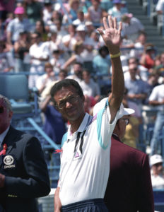 Tennis great Arthur Ashe waves to the crowd at the National Tennis Center in New York in this August 30, 1992. Photo by Ray Stubblebine/Reuters