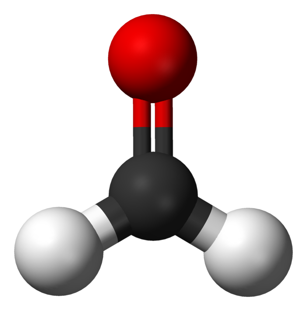 Picture a water molecule -- two hydrogen atoms attached to one oxygen atom. Now stick a carbon atom between the oxygen and hydrogens and you've got formaldehyde, pictured here as a ball-and-stick model. In the model, hydrogen is white, carbon is black, and oxygen is red.