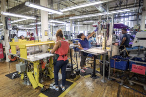 Workers assemble sneakers at the New Balance Inc. manufacturing facility in Lawrence, Massachusetts, U.S., on Tuesday, July 31, 2018. The U.S. Census Bureau is scheduled to release factory orders figures on August 2. Photographer: Scott Eisen/Bloomberg via Getty Images