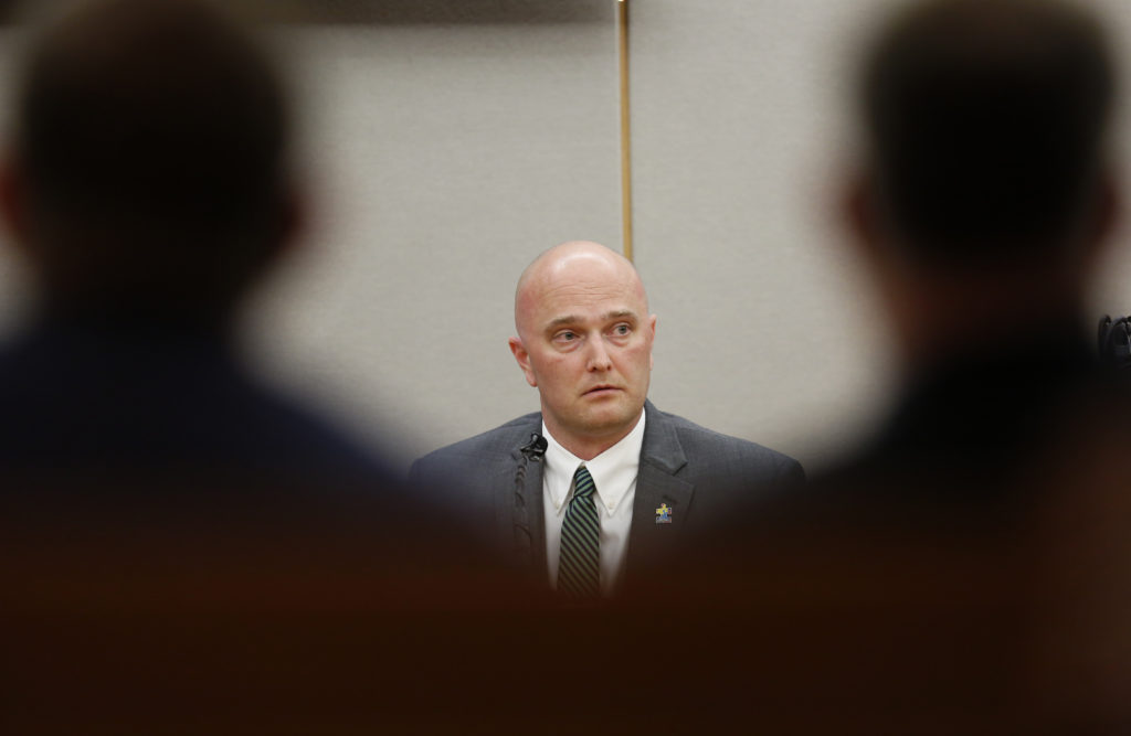 DALLAS, TEXAS - AUGUST 23: Fired Balch Springs police officer Roy Oliver, who is charged with the murder of 15-year-old Jordan Edwards, testifies with defense attorney Jim Lane during the sixth day of his trial at the Frank Crowley Courts Building in Dallas on Thursday, Aug. 23, 2018. (Photo by Rose Baca-Pool/Getty Images)