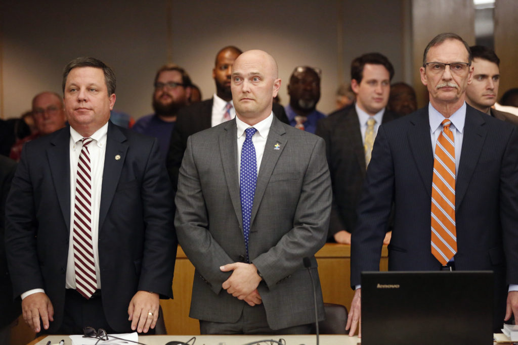 Fired Balch Springs police officer Roy Oliver (C) and attorneys Miles Brissette (L) and Bob Gill (R) stand before the reading of the verdict in the trial of Oliver, who was charged with the murder of 15-year-old Jordan Edwards. Photo by Rose Baca/Getty Images