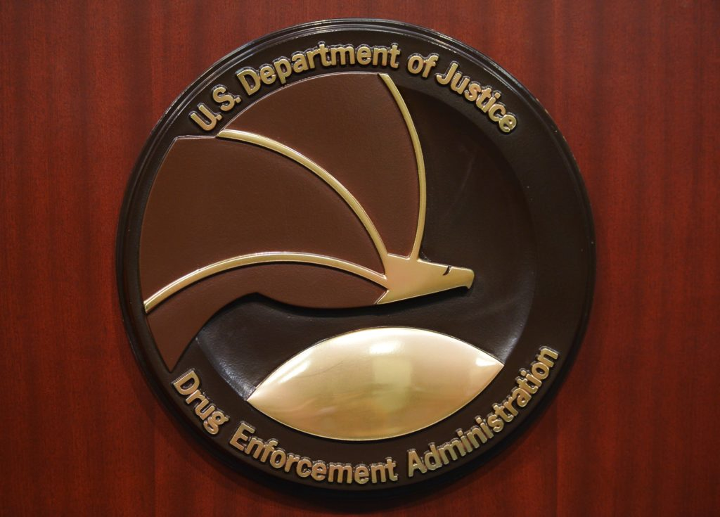 The seal of the Drug Enforcement Administration is seen on a lectern before the start of a 2013 press conference at DEA Headquarters in Arlington, Virginia. Photo by Mandel Ngan/AFP/Getty Images
