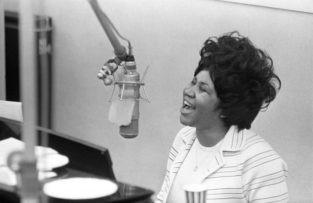 "NEW YORK, NY - JANUARY 09: Aretha Franklin sings in the Atlantic Records studio in during ""The Weight"" recording sesssion on January 9, 1969 in New York City, New York. (Photo by Michael Ochs Archives/Getty Images)"