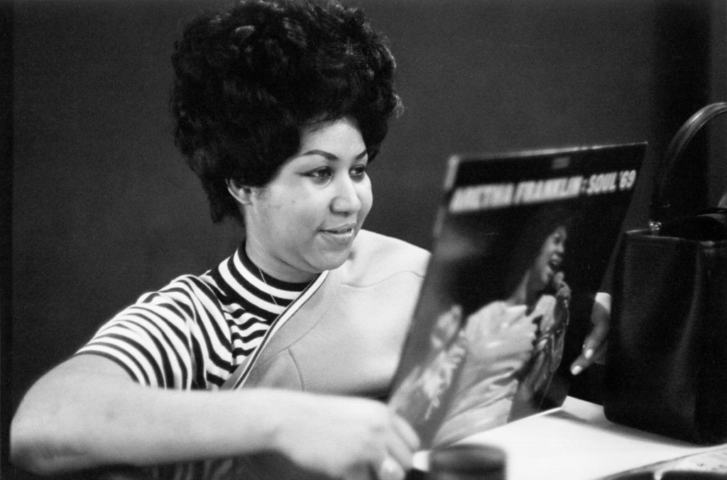 "NEW YORK, NY - JANUARY 09: Soul singer Aretha Franklin holds a copy of her ""Soul '69"" album in the Atlantic Records studios on January 9, 1969 in New York City, New York. (Photo by Michael Ochs Archives/Getty Images)"