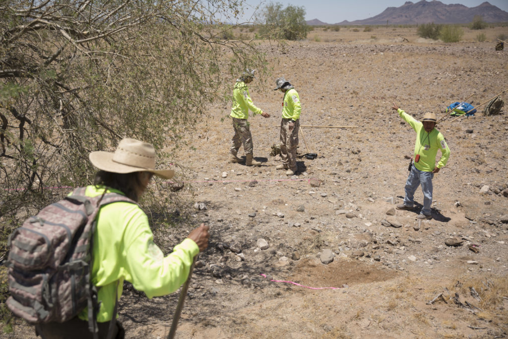 Aguílas del Desierto search and rescue crew mark off an area where human remains were found on May 27, 2017 in the Cabeza Prieta wilderness near Ajo, Arizona. (Photo by Caitlin O'Hara/Getty Images)