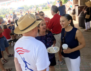Sharice Davids, a Democrat running for Congress in Kansas, talks to supporters at a July 4 event in Prairie Village. Photo by David Weigel/The Washington Post via Getty Images
