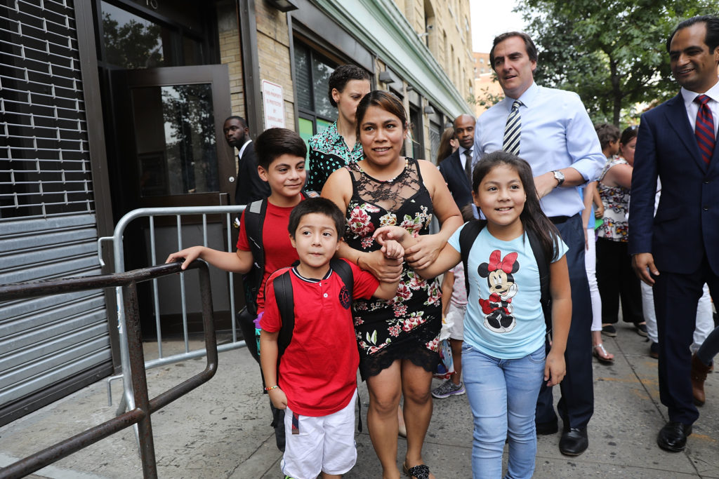Yeni Gonzalez-Garcia (center) was reunited with her three children at the East Harlem Cayuga Centers on July 13 in New York City. Gonzalez-Garcia, from Guatemala, was held away from her children as part of President Donald Trump's controversial zero-tolerance policy of removing immigrant children from their parents after they are detained. The policy was later reversed. Photo by Spencer Platt/Getty Images
