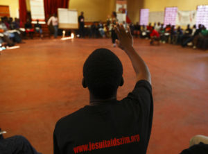 A participant takes part in a group session at a Youth Against AIDS training camp organised by the Jesuit AIDS Project in Domboshawa, around 80 km (49 miles) north-east of Harare, April 13, 2012. The Jesuit AIDS Project was launched in Harare in 1996 to fight the alarmingly high prevalence rate of HIV/AIDS in Zimbabwe and now focuses on prevention and youth development, according to organisers. Picture taken April 13, 2012. REUTERS/Darrin Zammit Lupi