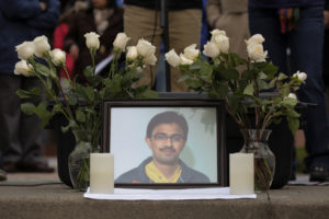 A picture of Srinivas Kuchibhotla, an immigrant from India who was recently shot and killed in Kansas, is surrounded by roses during a March 2017 vigil in honor of him at Crossroads Park in Bellevue, Washington, D.C. Photo by David Ryder/Reuters