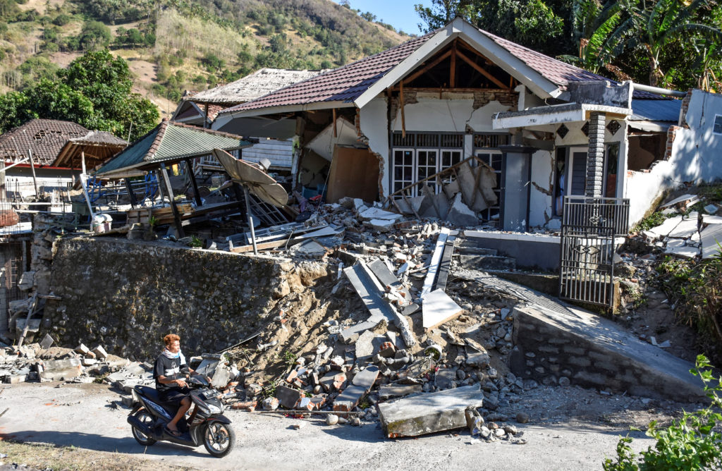 A home is damaged from Sunday's earthquake. An estimated 80,000 people were displaced. Photo by Antara Foto/Ahmad Subaidi via Reuters