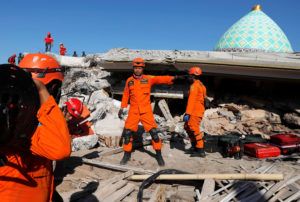 Rescue team members work at a site near a mosque after an earthquake in Pemenang, Lombok Island, Indonesia, on Aug. 8. Photo by Beawiharta/Reuters